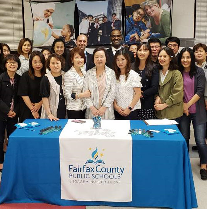 FCPS staff (two gentlemen in the back, center) met with friends and members of the Korean American Education Foundation about teaching for FCPS.