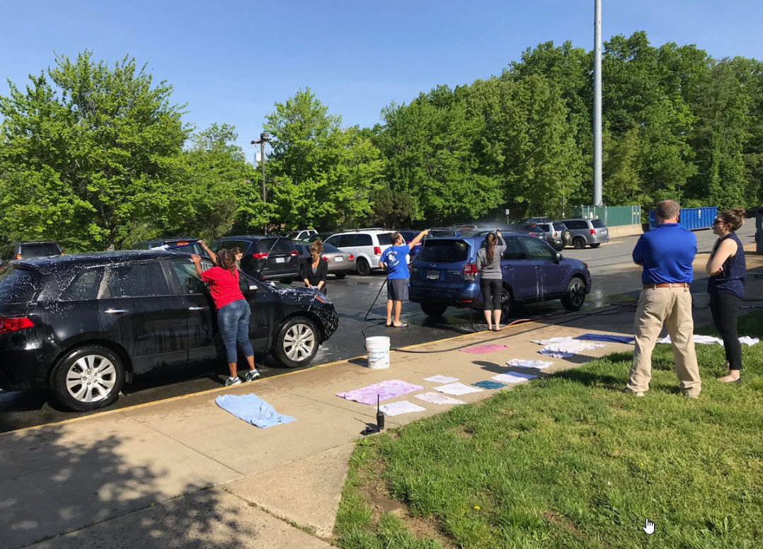 Administrators and parents wash teachers' cars at Irving MS for Teacher Appreciation Week.