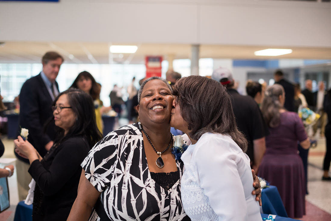 One woman hugs another at FCPS' Retirement Ceremony.