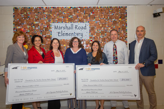 Principals and employees from Express Mobility present checks