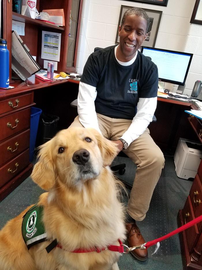 Carson MS Principal Gordon Stokes and the school's new therapy dog, Tucker
