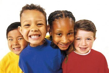 four children different ethnicity smiling