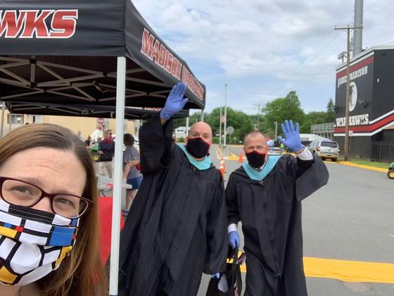 Melanie Meren and Madison HS administrators waving at graduates