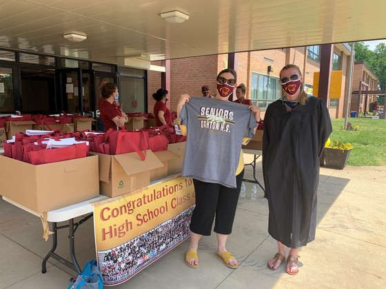 Melanie Meren modeling face mask and helping handout materials at Oakton HS
