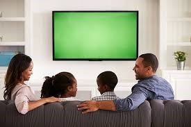 Family in front of TV screen picture