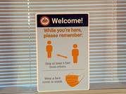 Signage reminding students to wear masks and practice social distancing.