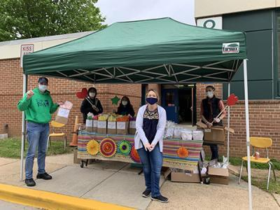 Fairfax Villa teachers distributing supplies