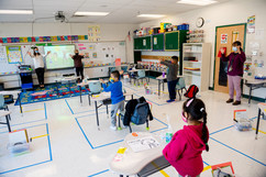 Classroom image with students and teachers