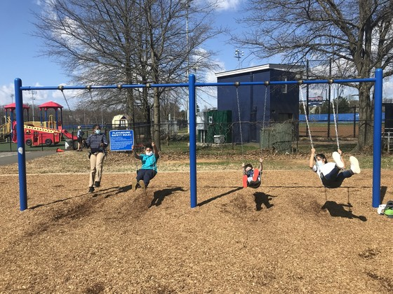 Photo of 5th grade students on the swings.