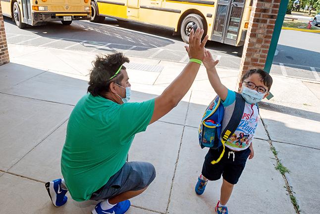 School Staffer high-fiving a student
