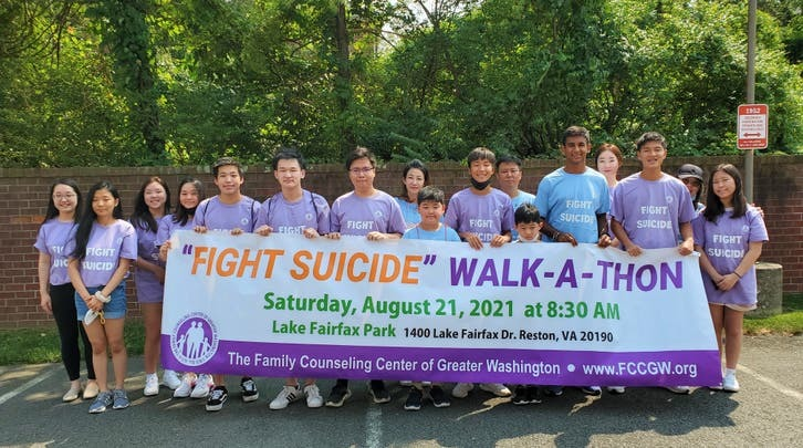 Fight Suicide Walkathon group picture with banner