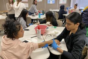 students practicing giving shots