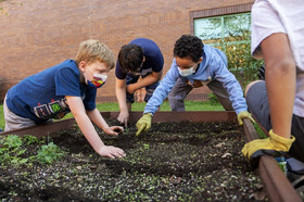 FCPS students planting seeds in Centreville Elementary garden