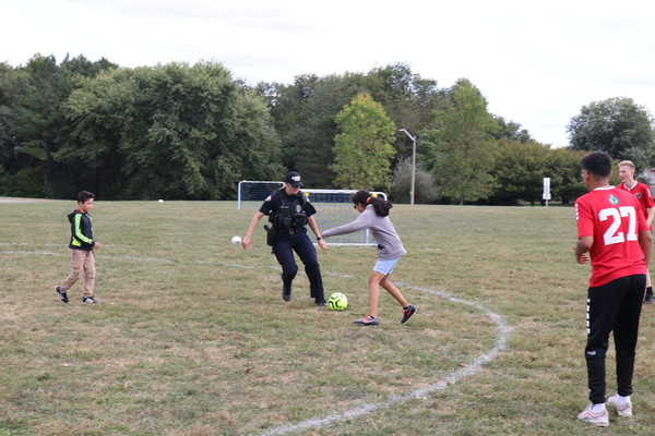 Officer Brickley Playing Soccer with Local Youths at Third Annual Fiesta Latina Community Event 2019