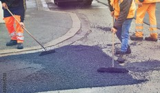 Workers paving