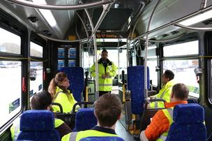 Potential coach operator applicants ride a bus at a Community Transit Job Fair
