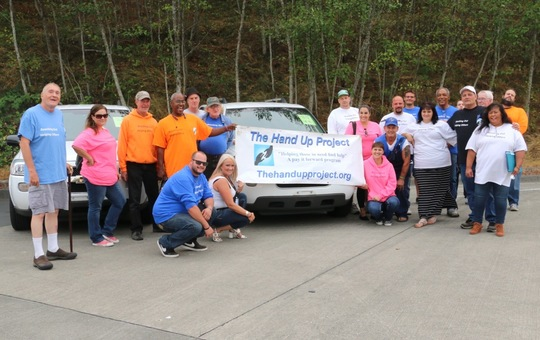 Hand Up Project Celebrates with their New Van GO Vehicle