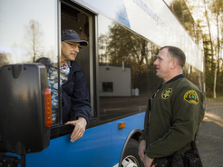 Coach Operator chats with Transit Officer