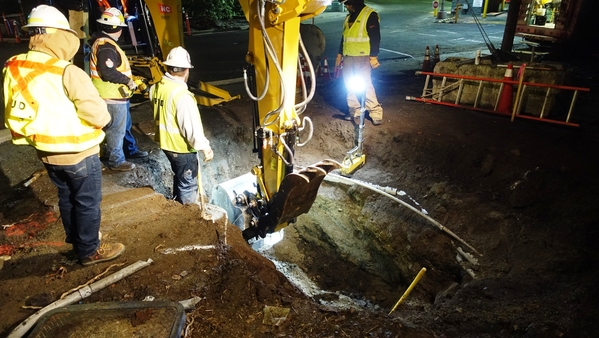 Early-morning crews install the foundation for one of the many light poles that will illuminate the new transit center.