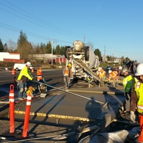 Crews put finishing touches on an in-lane bus pad along Airport Rd.