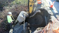 Hole for foundation of traffic pole on north side of 75th St.