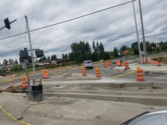 Traffic island on westbound 128th St and I-5 on-ramp