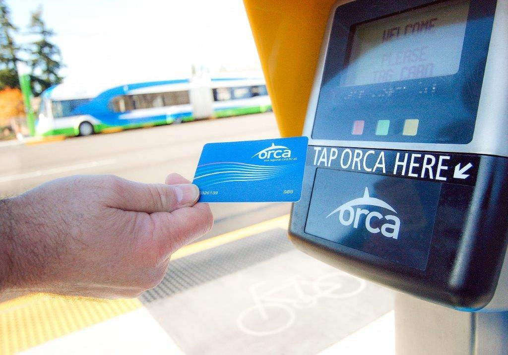 Picture of rider using ORCA card to pay fare at a Swift Station