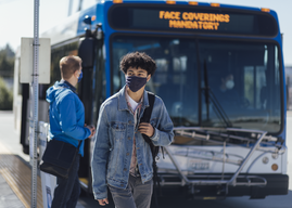Bus rider with face mask