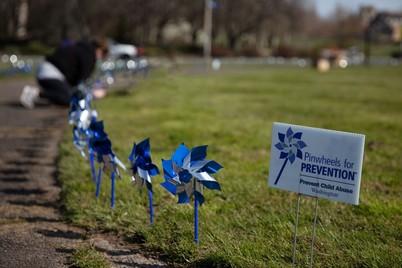 DCYF staff plant pinwheels on Capitol Campus.