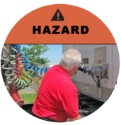 Image of a truck driver being put in a hazard situation.