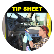 Image of a women truck driver cleaning the door and inside the cab.