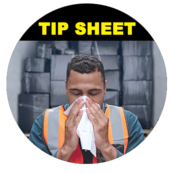 Image of driver sneezing over tissue with hands