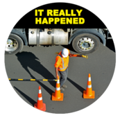 Image of truck driver putting down cones.