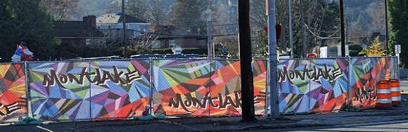 Colorful mesh screening along a fence with the word Montlake repeated on each screening panel.