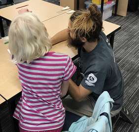 Image, WSC AmeriCorps member helping young student