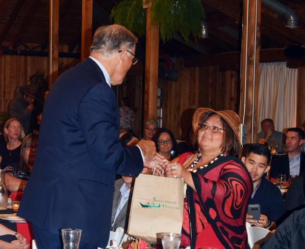 Suquamish Cultural Coordinator Tina Jackson shares gift with Washington State Governor Jay Inslee