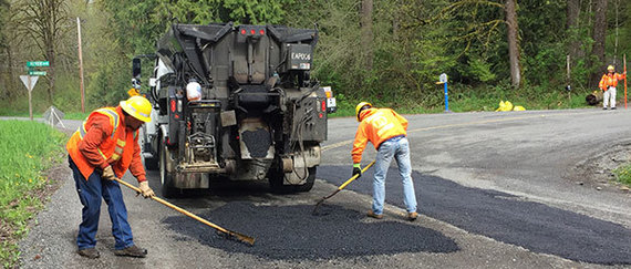 workers patching road surface
