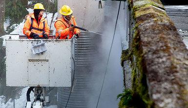 Two men cleaning bridge