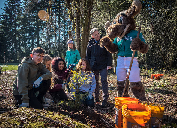 King County Executive Constantine planting a tree with kids