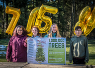 Students from Salmon-Bay elementary celebrate getting past the half-way mark of 1 Million Trees at Big Finn Hill Park