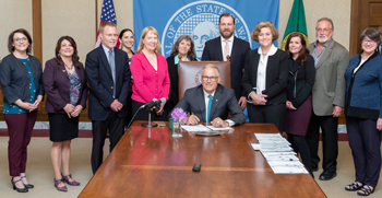 signing photo of plastic packaging stewardship study bill, May 21, 2019