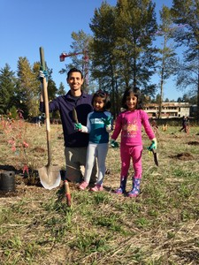 father and children planting at Marymoor Park