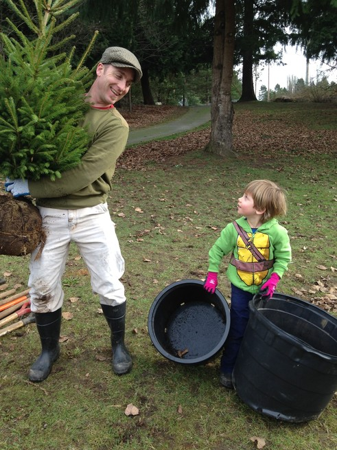 father and son planting