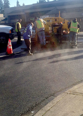 Paving crew at work on roundabout