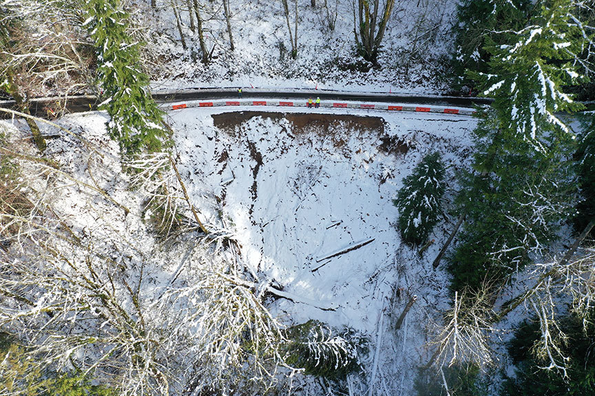 drone photo showing workers at landslide