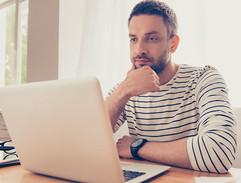 Man viewing laptop