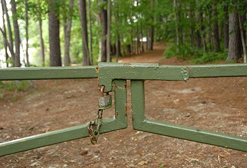 Photo: padlocked gate on trail