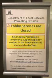 Closed sign on Permits office