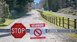 Photo: closed park gates with sign