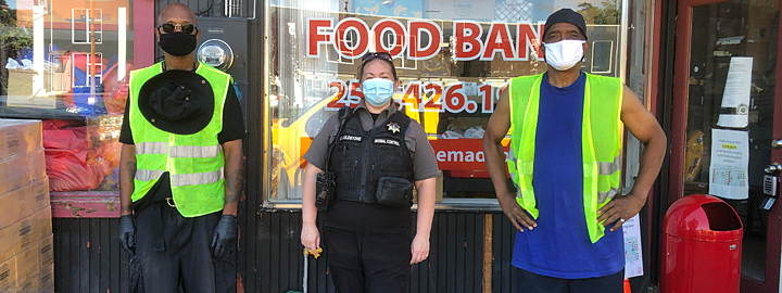 Animal services staffers at food bank
